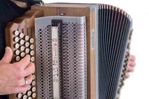 akordeonas,instrumentas,muzikinis instrumentas,liaudies muzika,klaviatūra,garsas,muzikos grotuvas,groti instrumentu,muzika