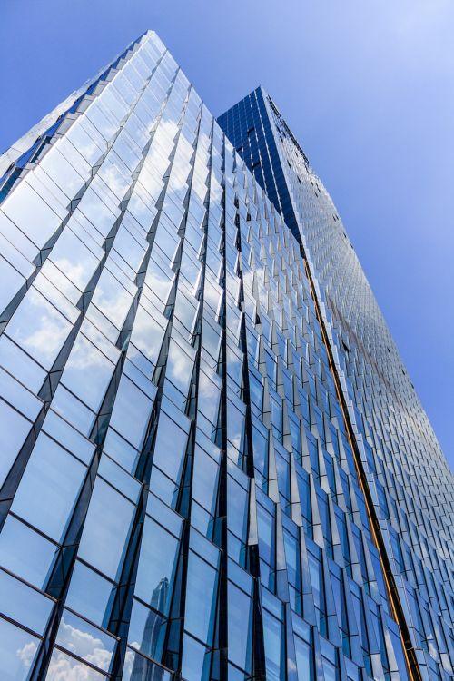 pastatas,aukštas pastatas,dangus,dangoraižis,architektūra,aukštas,miestas,miesto,bokštas,statyba,biuras,mėlynas,eksterjeras,centro,finansinis,įmonės,gatvė,turtas,atspindys,struktūra,miesto panorama,aukštas,rajonas,stiklas