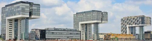 kranų namai,architektūra,Kelnas,šiuolaikiška,pastatas,stiklo langas,moderni architektūra,namai,Reino upė,rinas,Rheinauhafen,panorama,Vokietija,vandenys,upė,dangoraižiai,namai,biurų pastatai,gyvenamieji pastatai,biurų pastatas,plieno santvarų konstrukcija,įspūdingas,įspūdingas pastato formos,reginas,muitinės uostas,tektoninė koncepcija,fonas,fono paveikslėlis