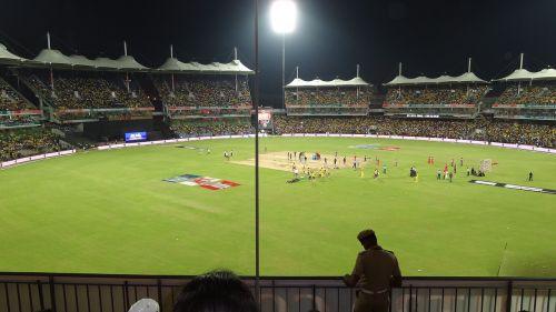 Kriketas,kriketo vieta,Sportas,žemė,laukas,stadionas,pikis,žolė,rungtynės,žaidimas,žaisti,šviesa,prožektorius,apšviestas,apšviestas,žalias