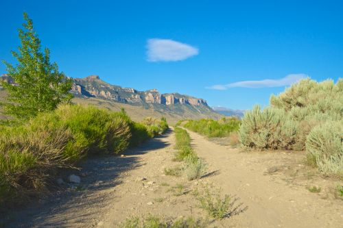 šepetys, krūmai, uolos, purvas, purvinas & nbsp, kelias, atstumas, aplinka, Persiųsti, žvyras, linija, kalnai, gamta, kelias, kelias, akmenys, dangus, tiesus, kelias, dykuma, Vajomingas, purvo kelias į kalnus