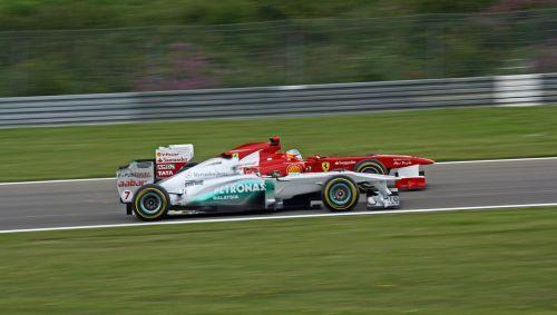 formulė 1,Mašinų lenktynės,greitis,motorsportas,lenktynės,ferrari,michael schumacher,Lenktyninio automobilio vairuotojas,Sportinė mašina,lenktyninis automobilis,greitai,lenktynės,vairuoti,jėga,transporto priemonė,lenktynes,akių lygis,lygus,greičiau,Pirmas,nugalėtojas,Knapp