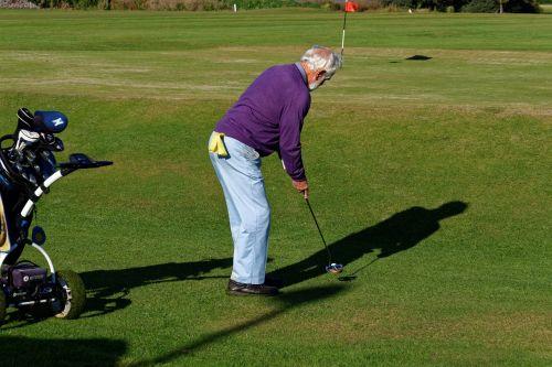 golfo žaidėjas,įdėti,žalias,vyras,golfo lazdos,lazda,golfas,Sportas,laisvalaikis,įdėti žalią,žolė,žinoma,žaidėjas,klubas,veikla,skylė,rutulys,golfas,žaisti,hobis,putt,Patinas,poilsis,žaidimas,lauke,golfo kamuoliukas,aktyvus,rekreacinė,golfo laukas