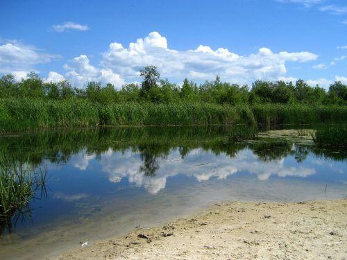didysis paplūdimys,lagūnas,ežeras Vinipegas,atspindys,debesys,manitoba