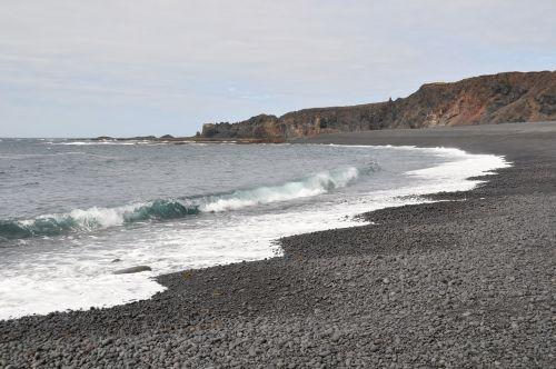 iceland,lava,papludimys,vanduo,Rokas,juodas akmuo