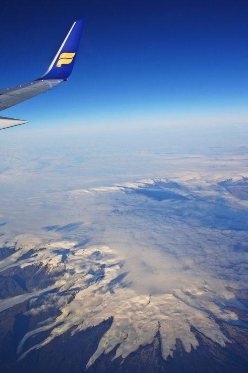 iceland air,orlaivis,aviakompanija,debesys,ledynas,iceland,dangus,horizontas,sala,mėlynas