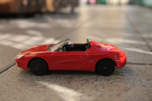 mašina,Žaislinė mašina,žaidimas,žaislas,ferrari,linksma,žaidimai,žaislai,saulė,ray,raudona mašina,automobilis,draudimas,vairuotojo pažymėjimas