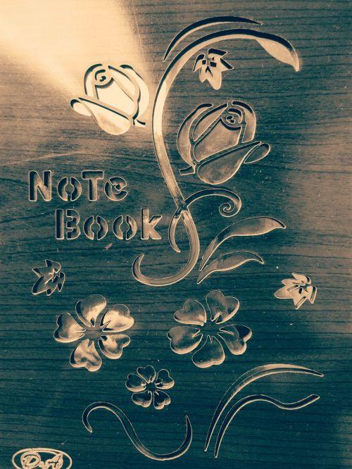 pastaba,knyga,gėlė