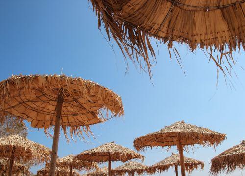 skėtis nuo saulės,Graikija,Crete,mėlynas dangus,papludimys,vasara,karštas,atostogos,šventė,kelionė,saulėtas
