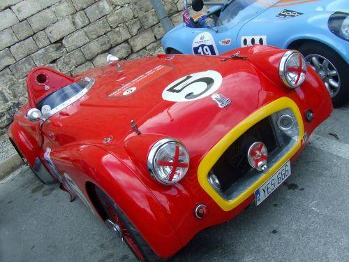 raudonas sportinis automobilis,raudona,automobilis,lenktynės,klasikinis,vintage,senovinis automobilis,klasikinis automobilis,mėlynas automobilis,Sportinė mašina,transporto priemonė,automobilis,automatinis,greitis,gabenimas,Sportas,lenktynės,dizainas,galia,vairuoti,variklis,kelias,raudona mašina,automobiliai,greitai,žiurkės išprotėjimas,triumfas tr2,triumfas,žvejys,Britanija,Anglų,transportas,greitas automobilis,stilius,metalas,blizgantis,brangus