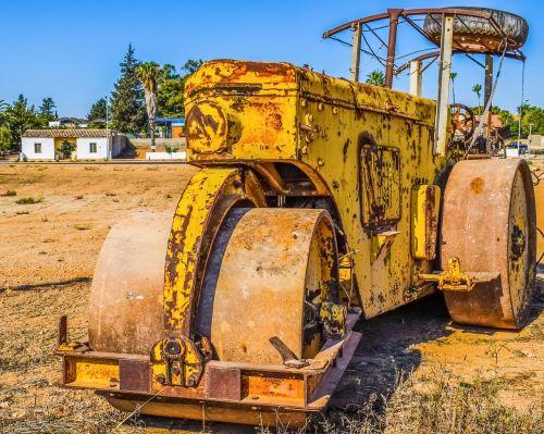 keltuvo volelis,sunki mašina,statyba,kompaktorius,senas,rusvas,geltona