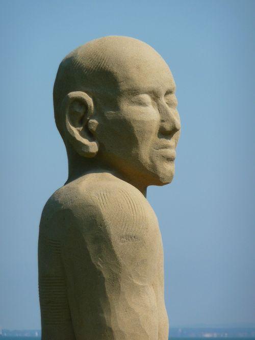 smėlio skulptūra,vyras,veidas,ežero konstanta,Rorschach