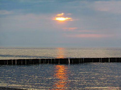 jūra,Baltijos jūra,vakaruose,papludimys,Baltijos jūros pakrantė,saulėlydis,vanduo,smėlis,vakaras