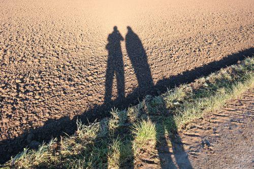 šešėlių žaidimas,Asmeninis,pora,vyras,moteris,ariamasis,ilgai,ištemptas ilgai,šešėlis,bendravimas