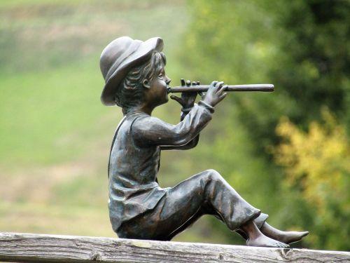 statulėlė,flutistas,karvės berniukas