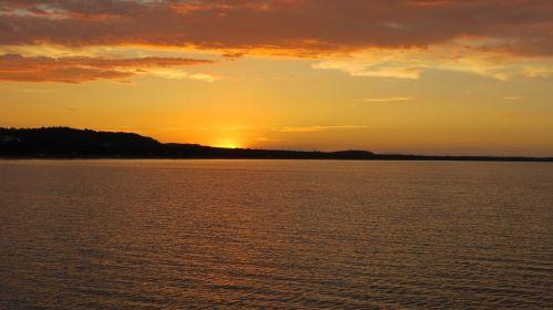 saulėlydis,romantiškas,auksinis,vanduo,vandens blizgesys,saulė,vakaras,rügen,Baltijos jūra,dangus,debesys,nuotaika,gamta,romantika