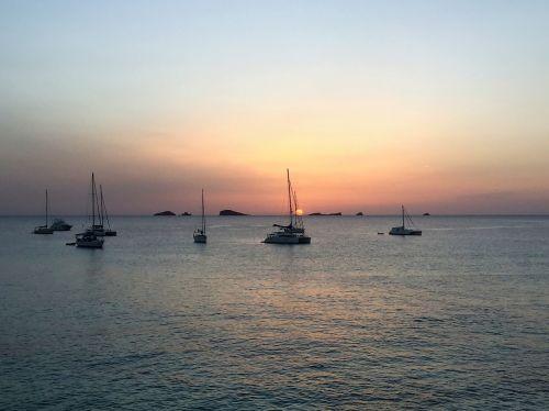 saulėlydis,ibiza,šventė,jūra,laivai,debesys,abendstimmung,vanduo,Balearų salos,atostogos,saulė,vakaras