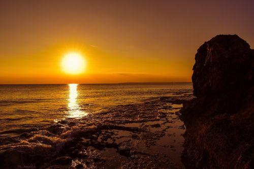 saulėlydis,saulė,dusk,jūra,Rokas,uolos pakrantė,dangus,gamta,kraštovaizdis,saulės šviesa,horizontas,oranžinė,ayia napa,Kipras