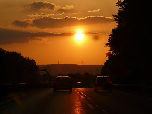 saulėlydis,saulė,debesys,dangus,afterglow,vairuoti,automatinis,kelionė,kelias,eismas,nuotolinis eismas,greitkelis