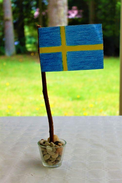 Švedijos vėliava,Švedijos vėliava,vasaros vasaros atostogos,galiolė,baigimas,studentų viršutinė riba,Nacionalinė diena,kavos pertraukėlė,Švedijos nacionalinė diena,vasaros pieva,Blomstertid,nacionalinė diena,Švedija