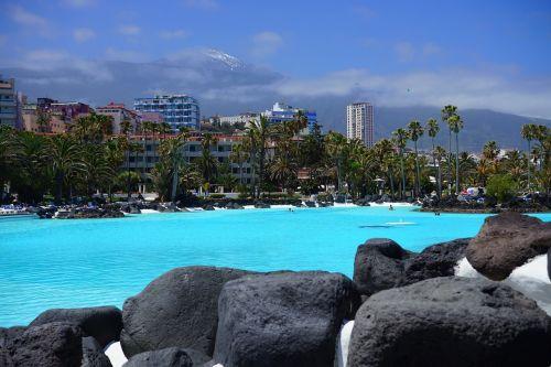 plaukiojimo baseinas,baseinas,plaukti,plaukiojimo baseinas,mėlynas,vanduo,atnaujinti,lauko baseinas,linksma maudytis,aišku,Saunus,šlapias,jūros vandens baseinas,lago martiánez,Puerto de la Cruz,Tenerifė,Kanarų salos,miestas,dangoraižiai,pico del teide,teide