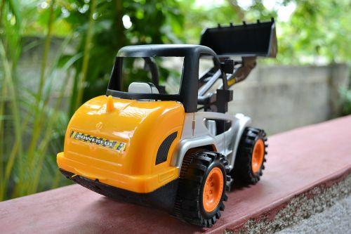 žaislas,plastmasinis,buldozeris,ekskavatorius,Iš arti,ratai,statyba,geltona,Šri Lanka,ceilonas,Mawanella